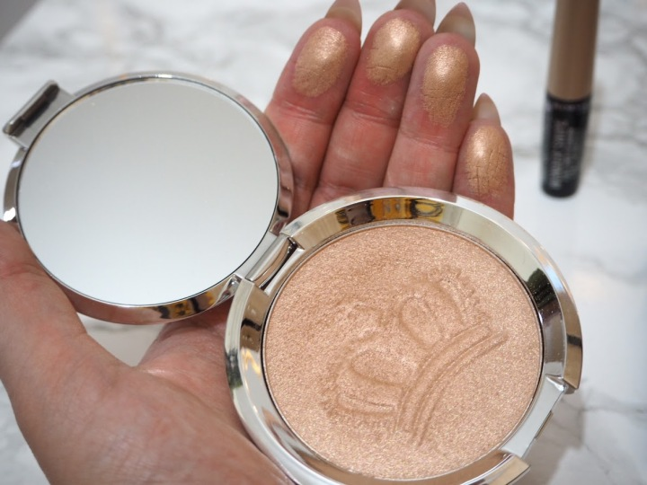 Becca Shimmering Skin Perfector in Royal Glow swatch